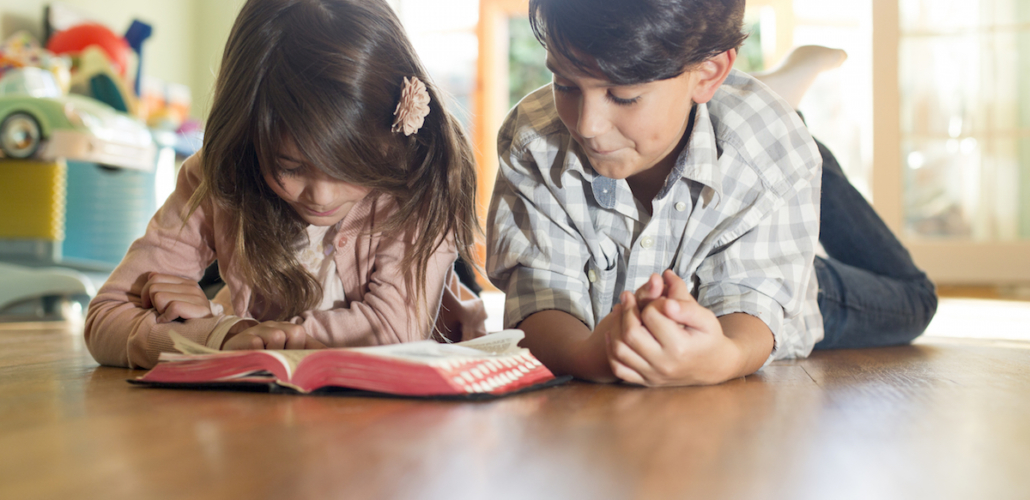 Siblings with Bible
